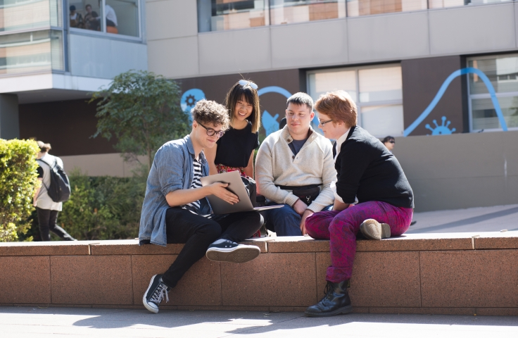 A group of UNSW students in discussion on campus