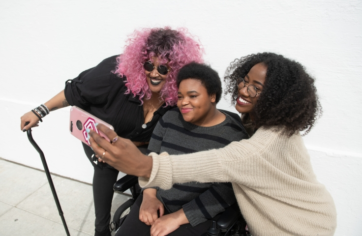 Three black and disabled students taking a selfie - Disabled and Here